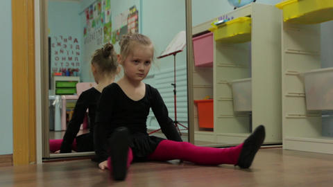 The Little Girl Ballerina Stretches Warmed GIF
