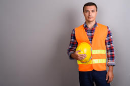 Man construction worker against gray background Photo
