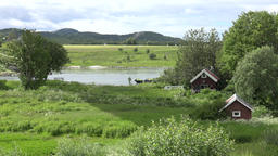 North Europe Norway Saltstraumen small wooden houses in green surrounding Footage