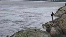 North Europe Norway Saltstraumen a single angler on the rocks 영상물