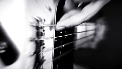 Bass Guitarist Playing Bass Guitar. Bursting Lights and Blured Video Archivo