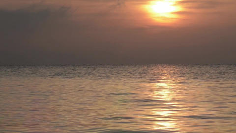 Sunrise over the sea with small waves generated by wind morning 2 Footage