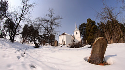 White church built in the middle of a pine envelope surrounded by a cemetery wit Footage