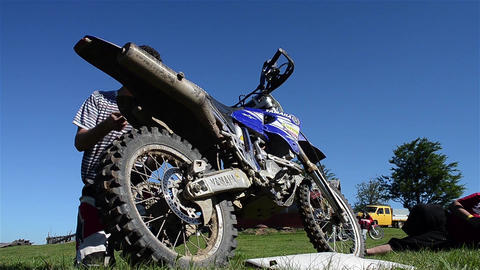 Motorcyclists after repair a motorcycle racing mounts at place elements of body Footage