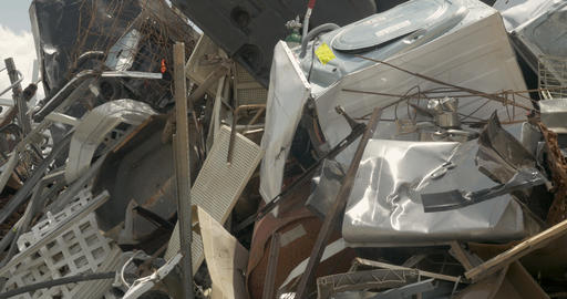 Large pile of scrap metal, broken, and discarded appliances at a junkyard, Footage