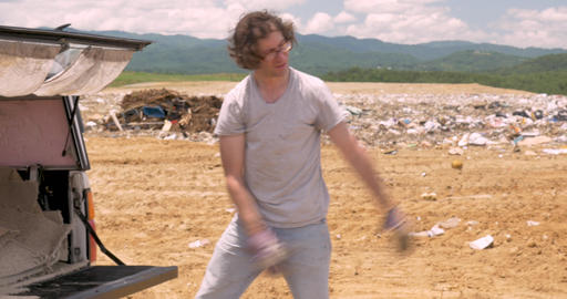 Man throwing old water damaged carpet away at a landfill out of a pickup truck Footage