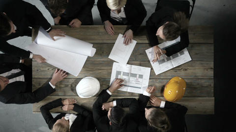 Business people with construction blueprint Footage