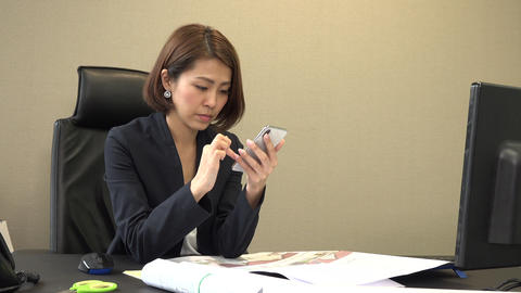 Tired Business Woman Typing On Mobile Phone In Office GIF
