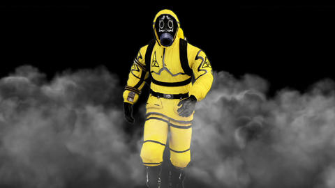 A man in a protective suit walks against the background of smoke. Loopable Animation
