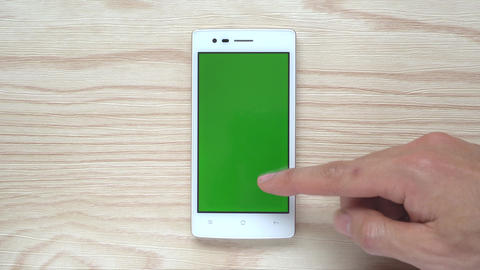Human Slide Smartphone or Mobile Phone Green Screen on Wood Background Filmmaterial