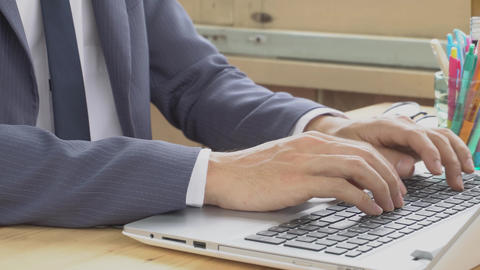 Businessman in Suit Typing Laptop in Home Office Normal View ビデオ