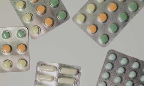 Medicines on a gray background of a different color Fotografía