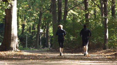 Running Man And Woman In Park stock footage