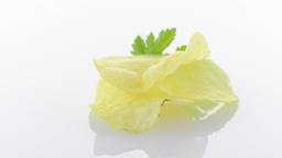 Potato chips and parsley Stock Video Footage