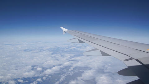 Airplane Wing And Blue Sky stock footage