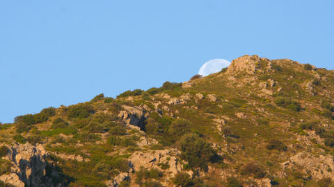 Moon set timelapse early morning, blue sky, day Footage