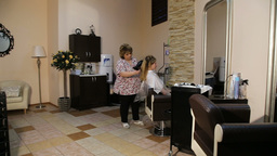 Hairdresser woman dries the hair dryer Footage