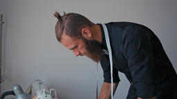 Handsome Bearded Designer is Sewing Fashionable Clothes in Own Atelier Footage