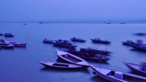 Indian pilgrims rowing boat in dawn, Ganges river in Varanasi, India Footage
