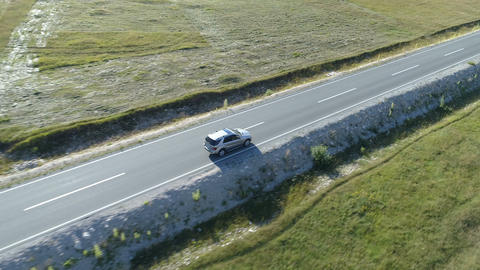 aerial view of a luxury car driving on country road Footage