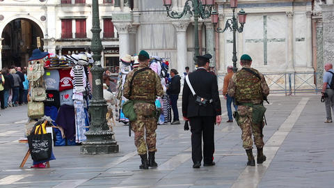 Policeman And Military With Uniform On Patrol On A Square In Venice Footage