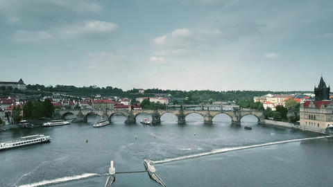 Aerial shot of the famous Charles bridge and the Vltava river tour boats in Footage