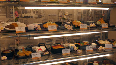 Japanese Restaurant With Traditional Food On Display In Window Live Action
