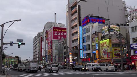 Road Traffic Cars Buildings Pedestrians In Ueno District Tokyo Japan GIF