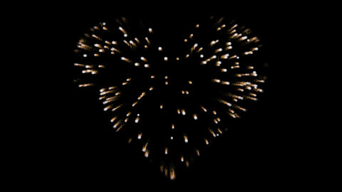 Gold fireworks in the shape of a heart. Alpha channel. Festive effect with gold Animation
