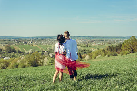 A beautiful young couple admires the landscape of the Ukrainian village フォト