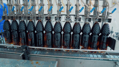The production line of carbonated beverages. water and soda in bottles GIF