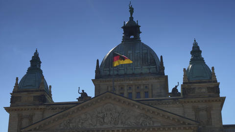 Waving German flag over the Federal Administrative Court building Live Action