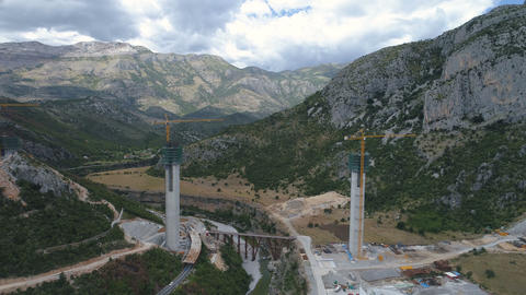 Construction of bridge columns of a new highway through the Moraca canyon in ビデオ
