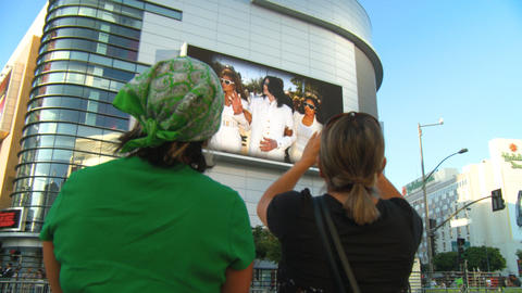 Fans Watch Jackson Memorial Slideshow Live Action