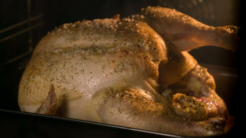 Cooking chicken in the oven Footage