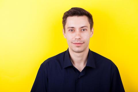 Portrait of male model in blue shirt フォト
