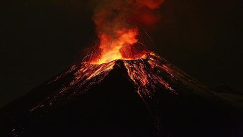 Tungurahua volcano exploding by night Footage