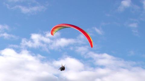 dual or tandem paragliding landing on rural area in Ecuador Footage