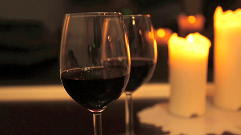 Two glasses of wine with candles Footage