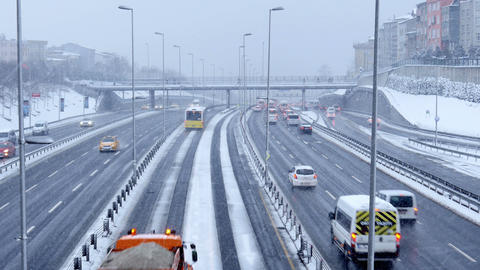 ISTANBUL, TURKEY - FEBRUARY 2015: Highway traffic on snowy day Footage