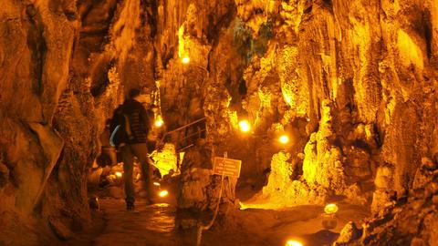 MENCILIS CAVE, SAFRANBOLU, TURKEY - APRIL 2015: tourist group travel stalactite Footage
