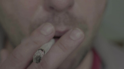 A man smokes a cigarette Footage