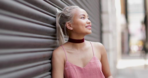 Portrait of young adult female with urban background Footage