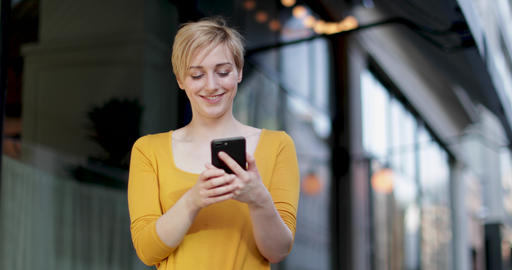 Young adult female laughing at smartphone Footage