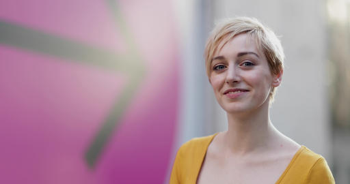 Portrait of young adult female with arrow sign in background Footage