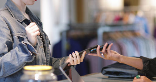 Closeup of customer paying with smartphone at checkout Footage