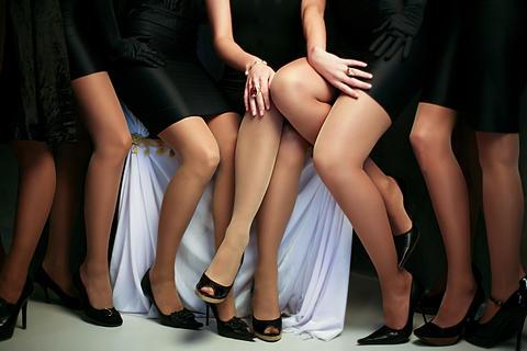 Crop female slender legs in group Photo