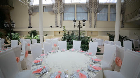 Wedding reception place ready for guests. Wedding dining table setting Footage