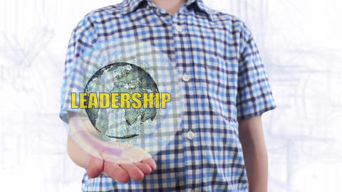Young man shows a hologram of the planet Earth and text Leadership Live Action