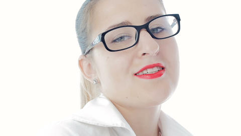 Slow motion footage of sexy elegant woman with red lipstick wearing eyeglasses Live Action